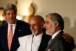 Afghan presidential candidates Ashraf Ghani Ahmadzai (C) and Abdullah Abdullah (R) smile next to U.S. Secretary of State John Kerry (L) after a news conference in Kabul July 12, 2014. The two rival candidates in Afghanistan's presidential election have agreed to abide by the results of a U.N.-supervised recount of the entire poll to settle their dispute over the outcome, Kerry said after talks with both men. REUTERS/Mohammad Ismail (AFGHANISTAN - Tags: ELECTIONS POLITICS)